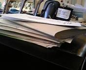 書類の山の正体は、